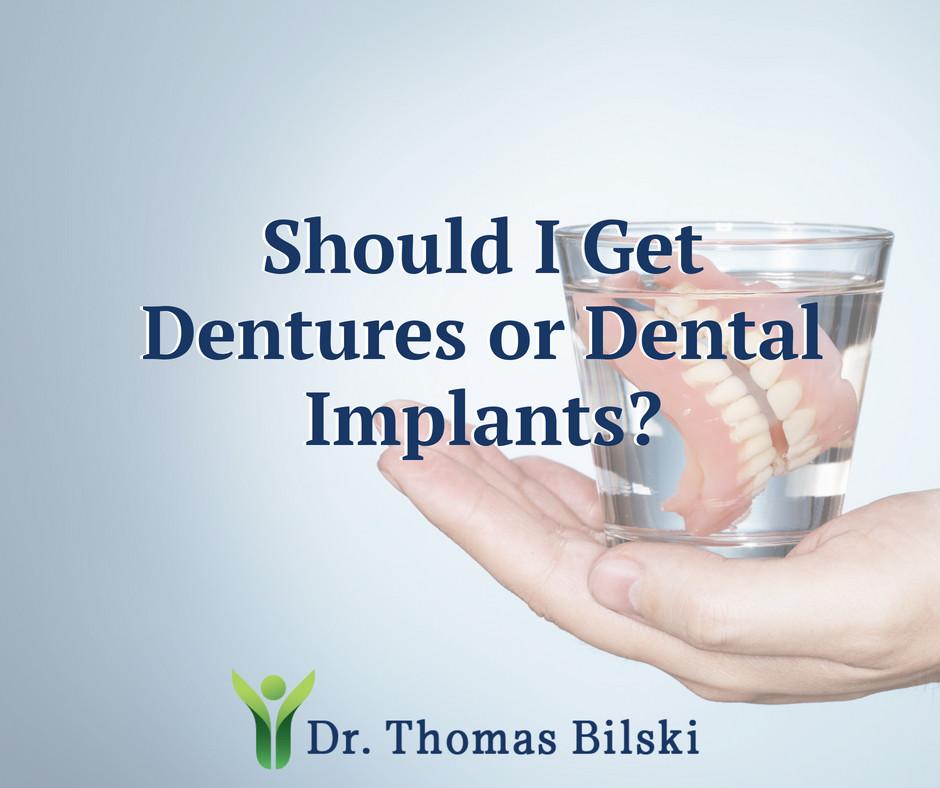 Should I Get Dentures or Dental Implants? Image