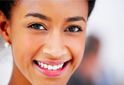 Woman with bright smile and dental implants