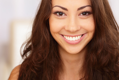woman smiling with big bright smile