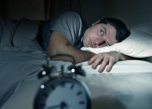 Man awake having trouble sleeping
