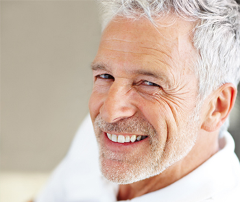elderly man with bright smile