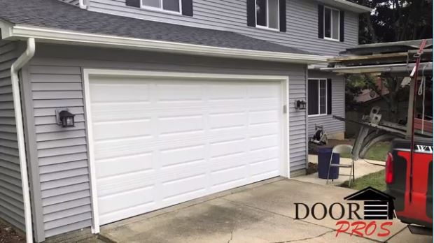 Picture of Home with New Siding and Beautiful New Garage Door | Garage Door Pros LLC of Cuyahoga, Lorain and Medina Counties