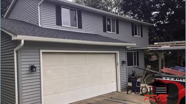 Picture of Home with New Siding and Old, Worn Down Garage Door | Garage Door Pros LLC of Cuyahoga, Lorain and Medina Counties