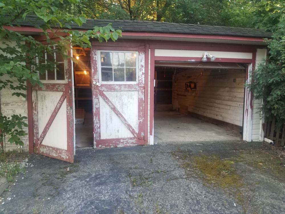 Before Photo, Two Car Garage with One Swing Door and One Overhead Garage Door, Both Doors need to be replaced
