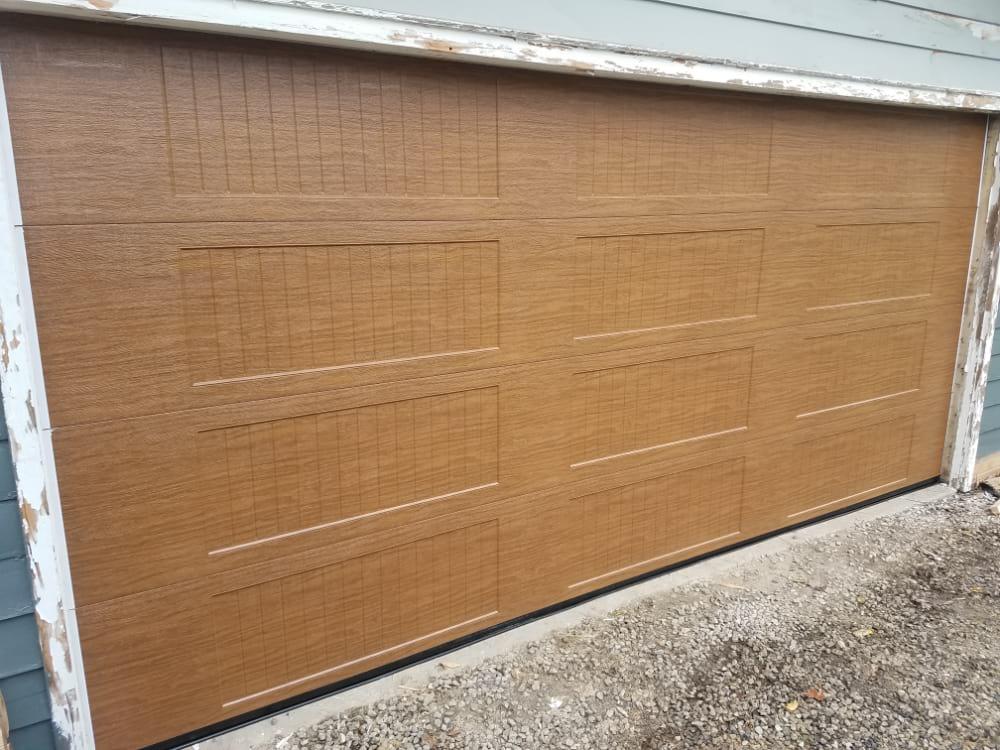 New Custom Garage Door Installation with a Wood Tone Color