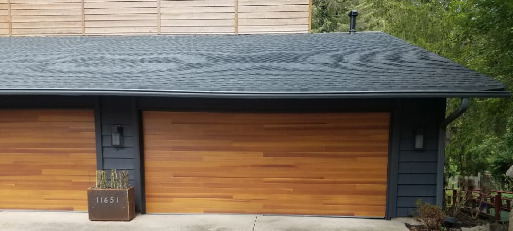 New Custom Plank Garage Door with Wood Look done by Garage Door Pros LLC of Ohio