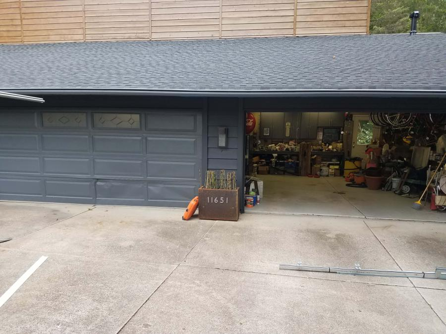 A Photo of a Garage Door before it was redone with a custom plank door design (wood finish)