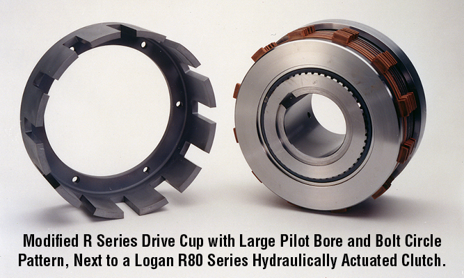 Modified R Series Drive Cup with Large Pilot Bore and Bolt Circle  Pattern, Next to a Logan R80 Series Hydraulically Actuated Clutch.