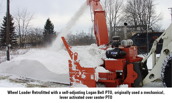 Wheel Loader Retrofitted with a self-adjusting Logan Bell PTO, originally used a mechanical, lever activated over center PTO