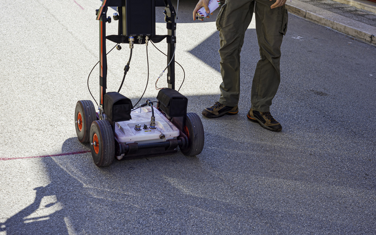 Ground penetrating radar used to detect voids in concrete.
