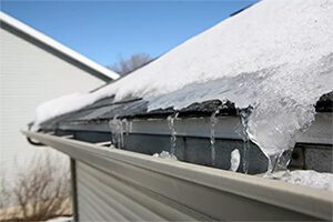 Ice-on-roof-and-gutters
